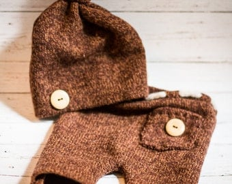 Baby hat and brown pants