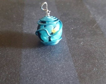 Blue caged bead pendant