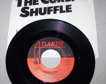 "Hit 45 rpm Record By Jump 'n The Saddle, ""The Curly Shuffle"""
