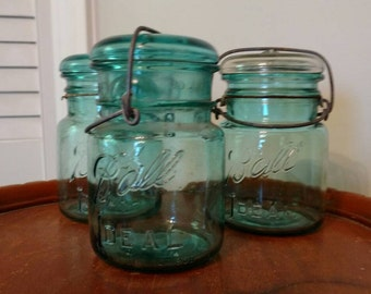 Set of 3 blue vintage Ball Ideal Mason jars with glass lids