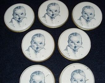 Seven Vintage Gerber Baby Food Tin Lids