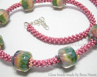 Beau's beads woven into pink