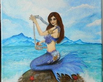 Mermaid and the sea