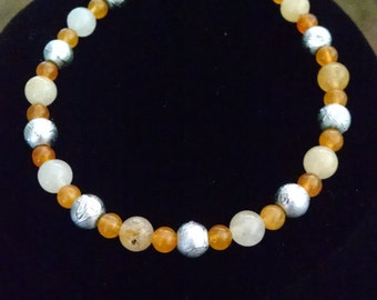orange and silver beaded bracelet