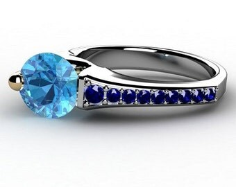 Blue Topaz and blue sapphire Floating Ring