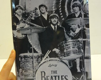 Photography of Beatles on metal plate