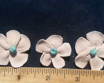 set of ten (10) pink and blue royal icing flowers