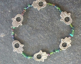 green, blue and purple glass beaded stretchy bracelet with hamsa hands