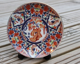 Pair of Decorative Red and Blue Kutani Plates