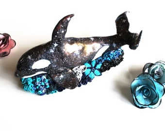 Killer whale galaxy on carpets of flowers in polymer clay