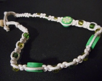 White braided friendship bracelet with Green Flower