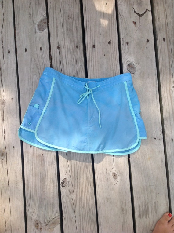Vintage light blue and seafoam windbreaker material swim skort. Would look great on dry land though! Athletic skirt, size small adult
