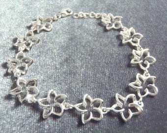 Sterling Silver Cutout Plumeria Flower Bracelet RB2