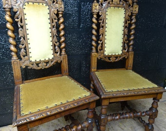 A pair of heavily carved oak barley twist chair's with studded yellow upholstery/Vintage/Antique/1900-1909