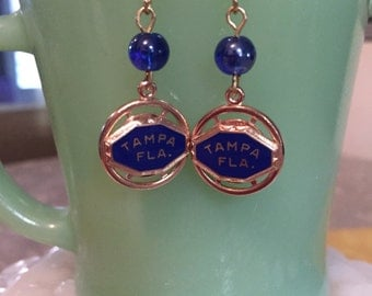 Tampa Florida- Vintage charms made into one of a kind earrings.