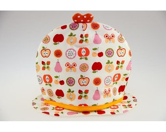 Covers teapot cotton ecru drawings fruits yellow, pink, orange.