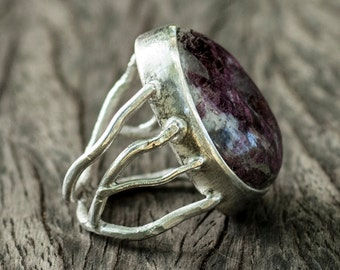 Abstract silver ring with tourmaline.