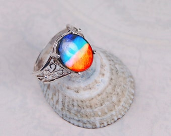 Ammolite jewelry ring.Spectacular colour changing Canadian Grade AA ammolite in Silver filigree ring