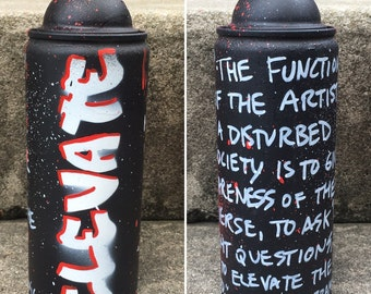 ELEVATE recycled spray paint can stencil art black white red