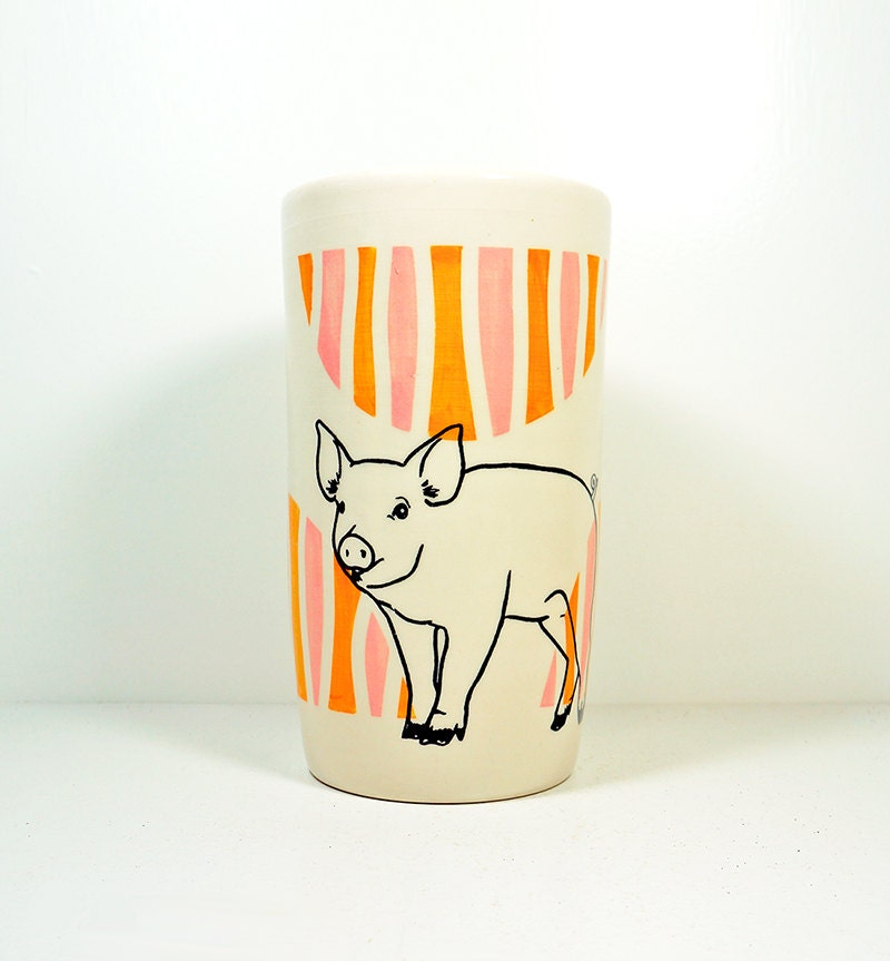 a tall cylinder flower vase/utensil holder with a Piglet on an Orange and Pink half-moon design. Ready to Ship.