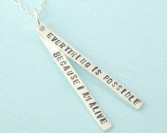 "Hand stamped quote necklace, ""Everything is Possible Because I'm Alive"" -Thich Nhat Hahn.  Sterling silver, made by Chocolate and Steel"