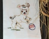 HAND EMBROIDERED Flour Sack Towel Embroidered with a cute little dog playing with a ball