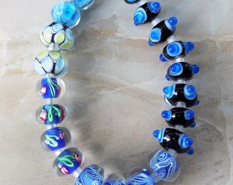 Orbit and Large glass rondelle beads