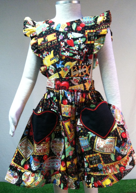 Little girls' bib apron with heart-shaped pockets