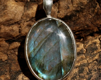Labradorite oval pendant in silver bezel setting with texture and oxidized