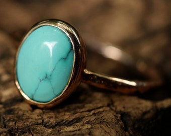 Blue turquoise oval ring in bezel setting with rose gold 14k texture band