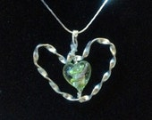 Floral heart pendant in Silver color!