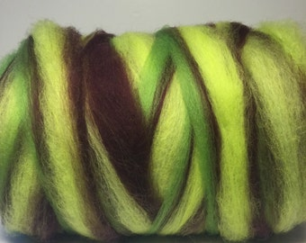 Merino wool self striping center pull roving bump. Tons of color changes Weighs 5oz Free  Ship