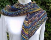 A little shawlette/scarf to keep your shoulders warm. Iris is knit from handspun wool yarn with a bit of sparkle, OOAK