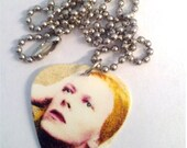 "Guitar pick necklace made with a David Bowie ""Hunky Dory"" pick."