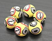 Reserved for JULIE Set of Polymer Clay Round Beads in Light Pastel Yellow with Millefiore Cane Slices In Black White and Red
