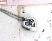 music notes. heart locket necklace. in silver ox jewelry tiny notes