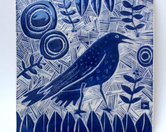 crow in blue hand carved ceramic art tile