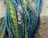 june flash sale FIJI MERMAID Handspun Art Yarn with Texture, Thick and Thin, Locks, Cocoon Bubbles, Sparkle. Blue-Green and Spun By Hand. Ab