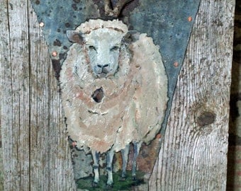 Sheep with bell on metal and barnwood