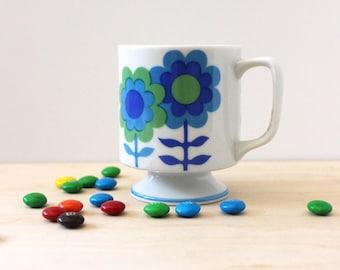 Vintage 1970s floral pedestal stacking mug. Green and blue.