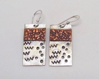 Mixed metal  earrings.