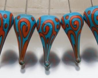 Lampwork headpins - Helix teardrops (1) - dark sky blue and orange on sterling silver wire. Lampwork by Jennie Yip