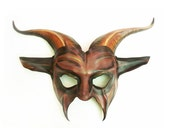 Leather Goat Mask in purples reds and black Abstract detail painting makes it look a little scary