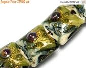 ON SALE 30% OFF Glass Lampwork Bead Set - Seven Emerald Treasure Pillow Beads 10505204