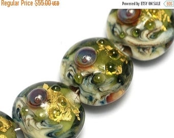 ON SALE 30% OFF Glass Lampwork Bead Set - Seven Emerald Treasure Lentil Beads 10505202