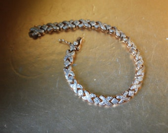 classy vintage 80s, sterling silver 925, X links, tennis bracelet with a marcasite details.