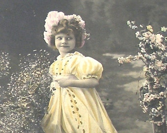 1900s French postcard, Girl in a yellow dress, RPPC real photo postcard, paper ephemera.