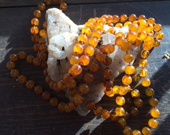 Vintage long amber plastic bead necklace
