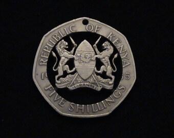 KENYA - cut coin pendant - Kenya Coat of Arms, Lions and Shield - 1985