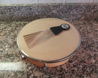 Nice LP tunable hand drum with wood rim- has tuning key and strumming device- great condition, ready to make music